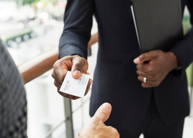 real estate agent handing out business card