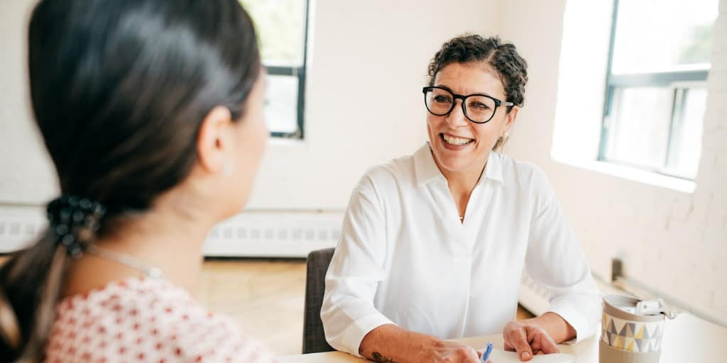 real estate woman talking to client