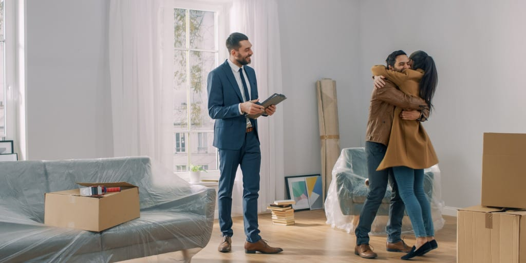 real estate agent helps couple buy house