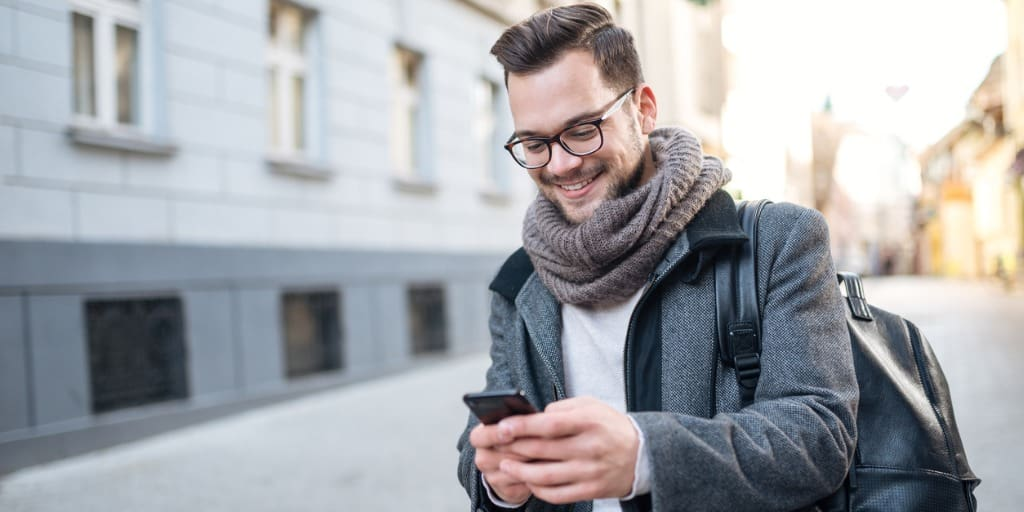 young professional texting on phone