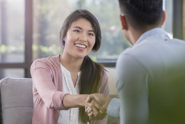 Handshake with young female professional - hiring a trainee appraiser