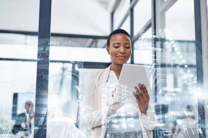 Multiple exposure shot of a mature businesswoman using a digital tablet in a building superimposed on a cityscape