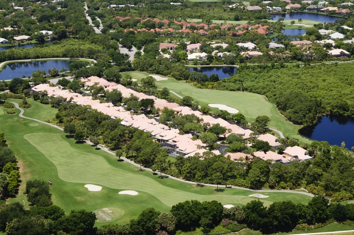 Overhead drone view of large luxury golf course community